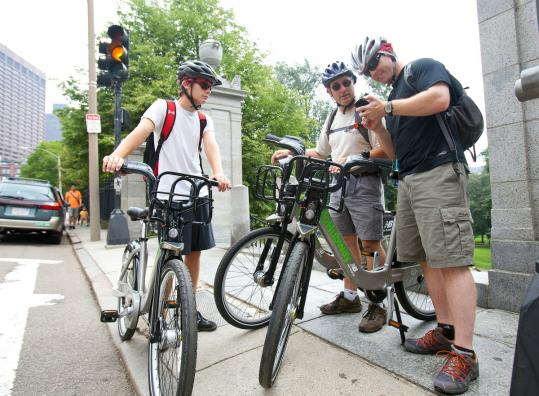 Noah Aubin, 16, his father, Gregg (center), and Brad Walton spent yesterday riding around Boston on Hubway bikes.