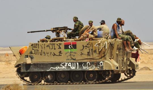 Obama calls on Libya's neighbors to arrest fleeing Gadhafi loyalists
