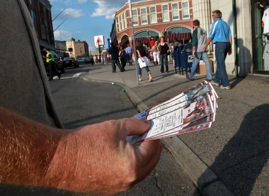 Scalpers routinely resell tickets outside Fenway Park.
