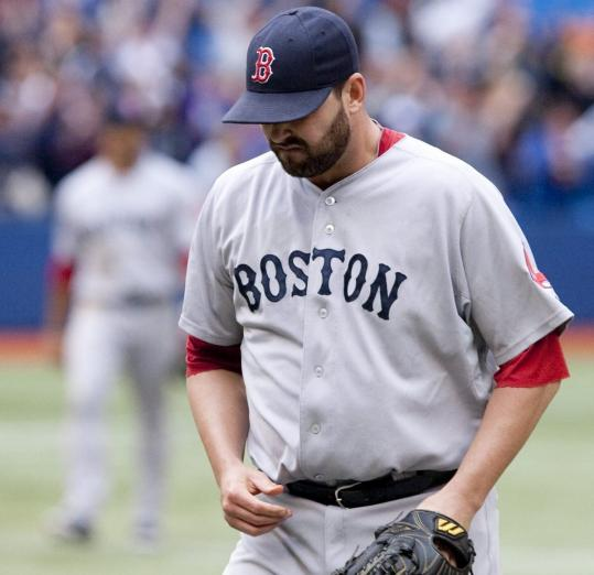 Red Sox reliever Dan Wheeler walks off after Brett Lawrie homered in the 11th for the Blue Jays.