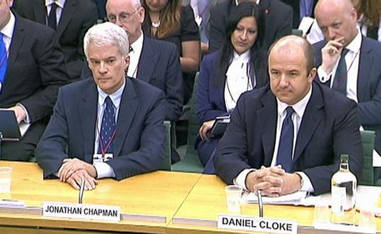 Jonathan Chapman (left) and Daniel Cloke, former News International executives, answered questions yesterday about what they knew and when in the phone hacking scandal.