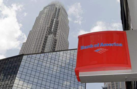 Bank of America's headquarters are shown in Charlotte, N.C. Two of its senior executives, Sallie L. Krawcheck and Joe Price, are out after a reorganization of its management team.