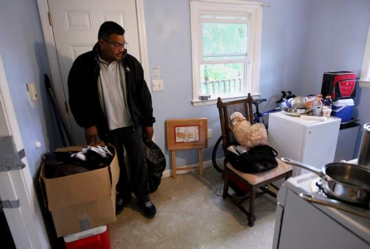 Elmo Benjamin packed, ready to leave his apartment near the Central Massachusetts campus in Lancaster.