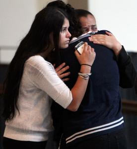 Alex Sierra's loved ones held each other yesterday after the arraignment of Ricardo Arias, the teen accused of killing him.