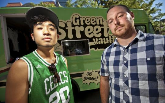 Derrick Cheung (left) and Howard Travis, co-owners of Green Street Vault. The two sell limited-edition clothing and sneakers from their truck.