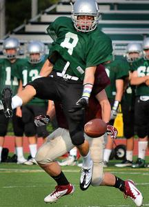 Duxbury's James Burke nearly intercepts a Weymouth pass during a recent scrimmage.
