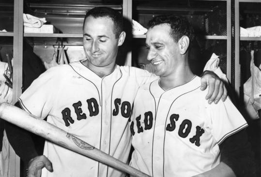 Pitcher Bill Monbouquette (left) with Red Sox teammate Frank Malzone after a 2-1 victory in 1962.