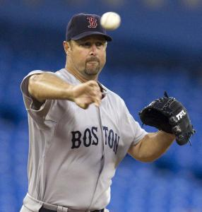 Tim Wakefield, who lasted five innings and left with the lead, throws to first to hold a runner in the second inning.