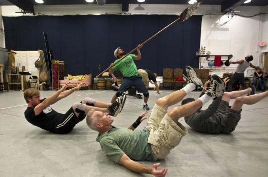 "Members of the Huntington Theatre Company rehearse a scene from ""Candide,'' directed by Mary Zimmerman."