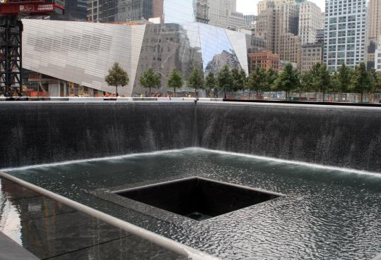Two large sunken pools lined with waterfalls are the focus of the National 9/11 Memorial in New York City.