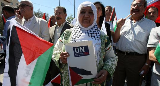 Palestinians rallied outside a United Nations building yesterday in the West Bank city of Ramallah.