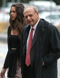 Salvatore F. DiMasi arrived at federal court yesterday with stepdaughter Ashley.