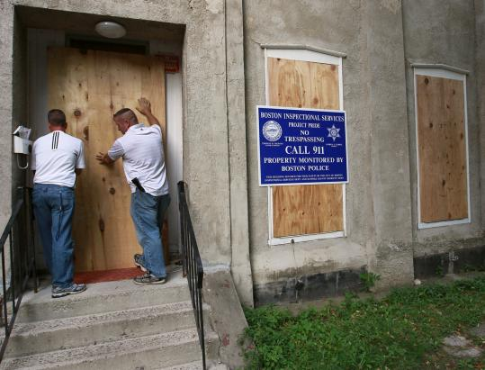 City of Boston Code Enforcement inspectors boarded up the doors and windows of a two-story building at 100 Mount Pleasant Ave. in Roxbury, for a slew of code violations on Aug. 31.