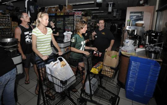 Shoppers bought supplies at a Encinitas, Calif., store during a blackout yesterday that took two nuclear reactors offline.
