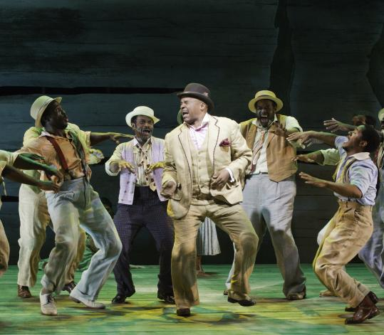 "David Alan Grier (center) and fellow cast members ""The Gershwins' Porgy and Bess.''"