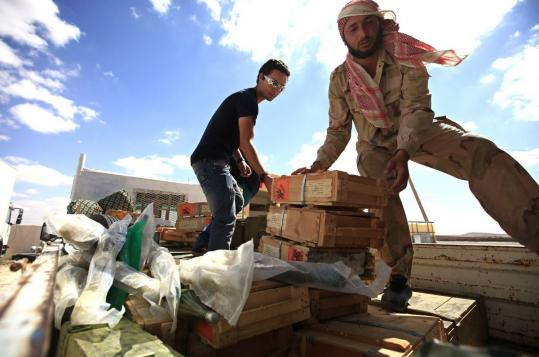Anti-Khadafy fighters prepared dozens of crates of Russian-manufactured ammunition at a rebel position north of Bani Walid.