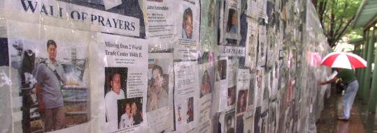 A wall in NewYork bore images of those unaccounted for just after 9/11. In the decade since, 400,000 have died on US roads.