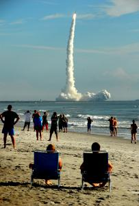 A Delta II rocket carrying Grail-A and Grail-B blasted off from Cape Canaveral yesterday as spectators watched from a beach.