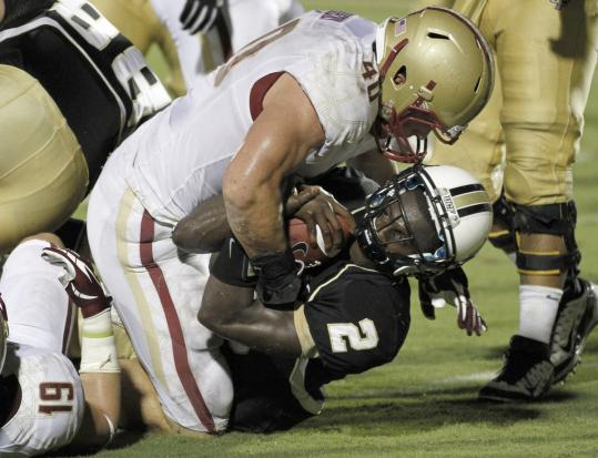 BC's linebacker Luke Kuechly, who finished with 17 tackles, can't keep Jeff Godfrey out of the end zone.