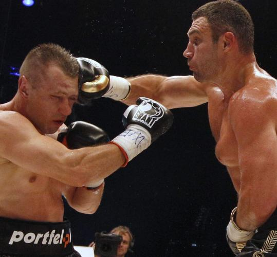 The huge size advantage of Vitali Klitschko (right) was apparent against challenger Tomasz Adamek in a bout that ended in the 10th round.
