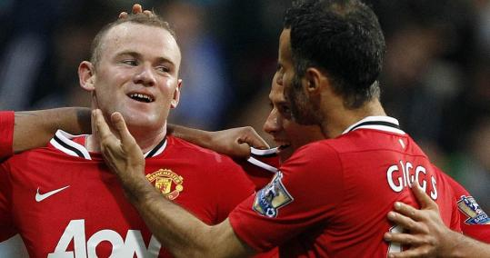 Wayne Rooney (left) had three of the five goals scored by Manchester United, which is 4-0 in the Premier League.