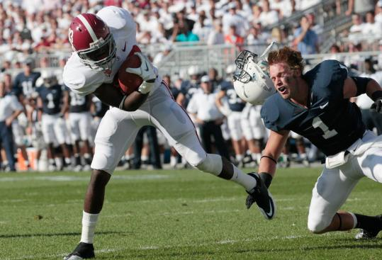 After losing his helmet, Penn State defender Nick Sukay lost track of Alabama receiver Kevin Norwood on a first-half completion.