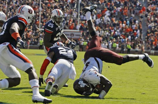 Auburn defensive back Ryan Smith upends Mississippi State quarterback Chris Relf at the goal line on the game's final play, preserving the Tigers' 41-34 victory.