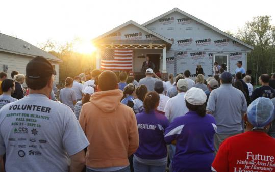 Volunteer home builders listened to Habitat for Humanity executive Danny Herron at a project site yesterday in Nashville.