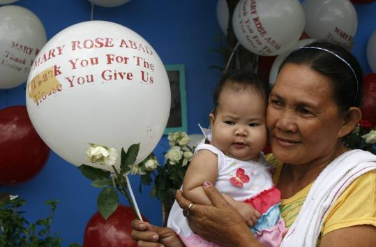 A memorial was held in Manila for US citizen Marie Rose Abad, whose husband built 50 homes to remake a village there in 2004. The 9/11 victim's wish was to aid impoverished Filipinos.
