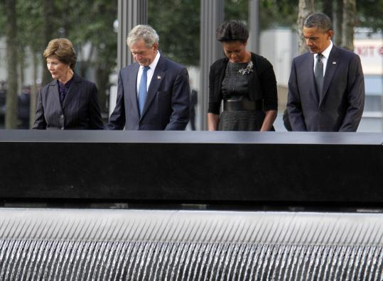 Laura Bush, George W. Bush, Michelle Obama, and President Obama at the National September 11 Memorial yesterday.