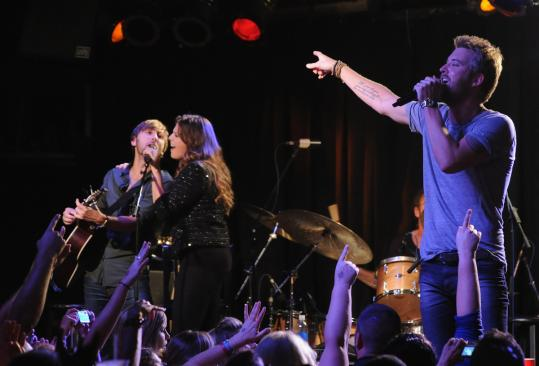 Dave Haywood (left), Hillary Scott, and Charles Kelley performed songs from &#8216;&#8216;Own the Night&#8217;&#8217; at Joe&#8217;s Bar in Chicago over the weekend.