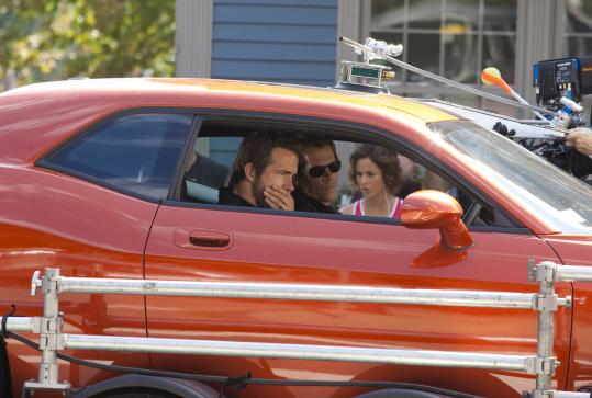 From left: Ryan Reynolds, Kevin Bacon, and Stephanie Szostak filming 'R.I.P.D.' yesterday in Charlestown.