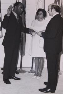 Mr. Gittens is shown in 1971 with his wife, Ruthe, as he was sworn in as special agent in charge in Washington, D.C.