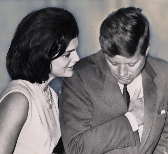 Jacqueline Kennedy speaks with her husband, President John F. Kennedy.