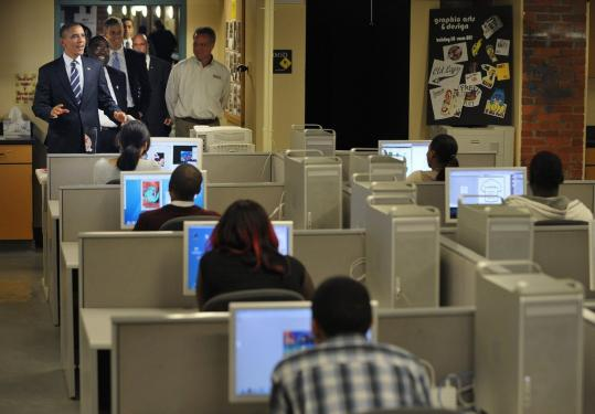 President Obama checked out a graphic design classroom yesterday during a visit to a Columbus, Ohio, high school.