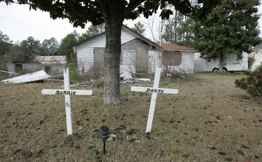Crosses marked the yard in 2007 where two o