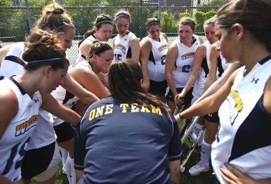 At Wheelock College, where field hockey coach Rachael Johnson (center) huddled with her team, emphasis is on effort.