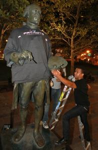 William Linares, working for the NFL Network, placed a Patriots hoodie on the John Singleton Copley statue.