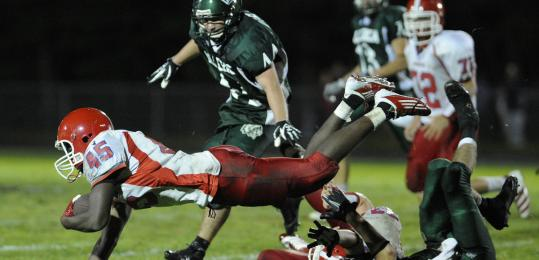 Burlington junior back Marcus Odiah (45) cranked out 98 yards and a touchdown on 20 carries during Friday's 49-28 nonleague loss to Billerica.