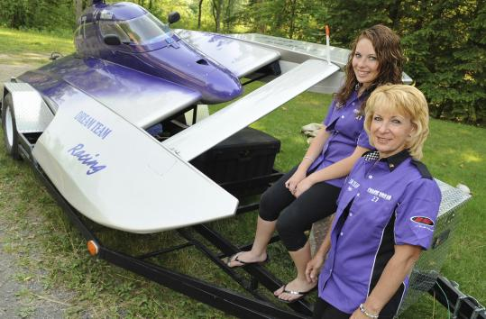Leah and Jan Hoosick, a mother-daughter hydroplane racing team, at home in Amesbury with their boat, Chaotic Dream.