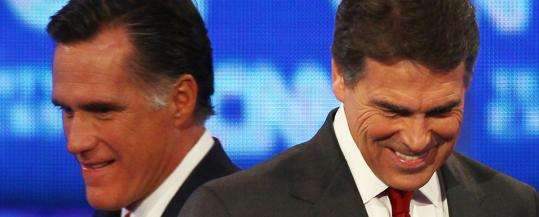 Mitt Romney, left, and Rick Perry are jockeying for front-runner status.