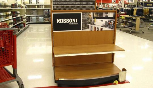 Empty shelves remained after shoppers bought out much of US retailer Target's new Missoni fashion line at a store in Vista, Calif., on Tuesday.