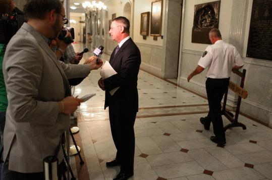 Representative Joseph F. Wagner chatted with reporters before the House voted last night to authorize three resort casinos and one slots-only gambling parlor in Massachusetts.