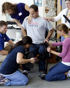 A crew of physical therapists and a team from Berkeley Bionics worked with David Leone to test new technology that will help him take steps.