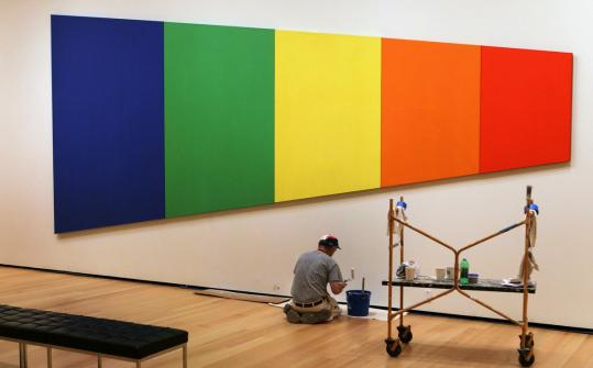 "Mike Walsh put the finishing touches on the Museum of Fine Arts Catherine and Paul Buttenwieser Gallery. He's working below Ellsworth Kelly's ""Blue Green Yellow Orange Red.'' The museum opens its new Linde Family Wing for Contemporary Art this weekend."