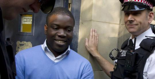 UBS trader Kweku Adoboli (center) headed to a van flanked by police officers after appearing in a London court yesterday. Adoboli, 31, allegedly lost billions of dollars in unauthorized trading.