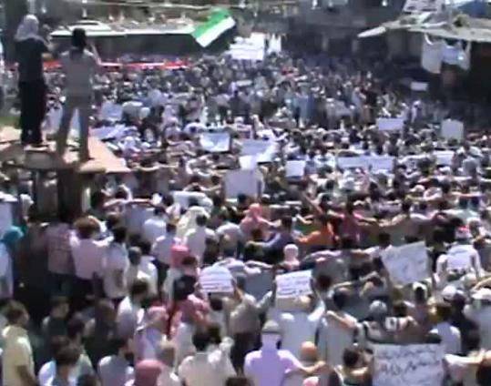 An image grab from footage uploaded on YouTube shows what proreform activists said was a protest against Syrian President Bashar Assad in a Damascus suburb yesterday.