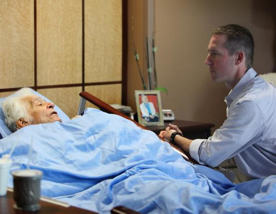 Joe Ackerman, shown with a patient at Merrimack Valley Hospice House, said the job has helped him appreciate life.