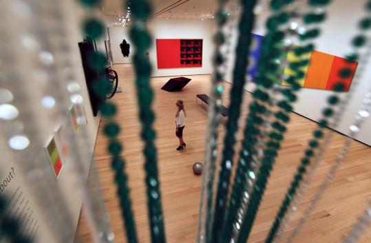 A floor-to-ceiling curtain of beads serves as an entryway to a gallery at the Museum of Fine Arts.