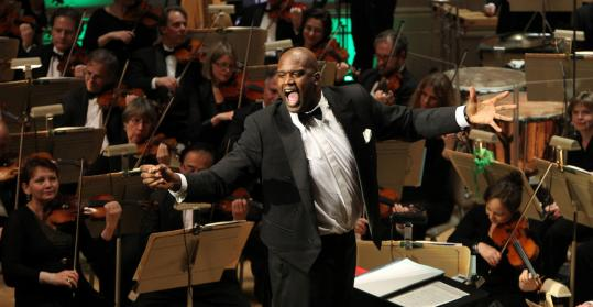Shaquille O'Neil tries his hand at conducting the orchestra during a Holiday Pops Concert at Symphony Hall last season.